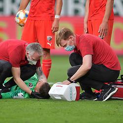 Spiel am 35 Spieltag in der Saison 2019-2020 in der 3. Bundesliga zwischen dem FC Ingolstadt 04 und dem SV Waldhof Mannheim am 24.06.2020 in Ingolstadt. <br /> <br /> Torwart Fabijan Buntic (Nr.24, FC Ingolstadt 04) wird verletzt am Boden behandelt<br /> <br /> Foto © PIX-Sportfotos *** Foto ist honorarpflichtig! *** Auf Anfrage in hoeherer Qualitaet/Aufloesung. Belegexemplar erbeten. Veroeffentlichung ausschliesslich fuer journalistisch-publizistische Zwecke. For editorial use only. DFL regulations prohibit any use of photographs as image sequences and/or quasi-video.