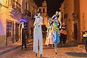 Stilt walkers dressed as skeletons walk through the streets during the Day of the Dead festival November 1, 2016 in San Miguel de Allende, Guanajuato, Mexico. The week-long celebration is a time when Mexicans welcome the dead back to earth for a visit and celebrate life.