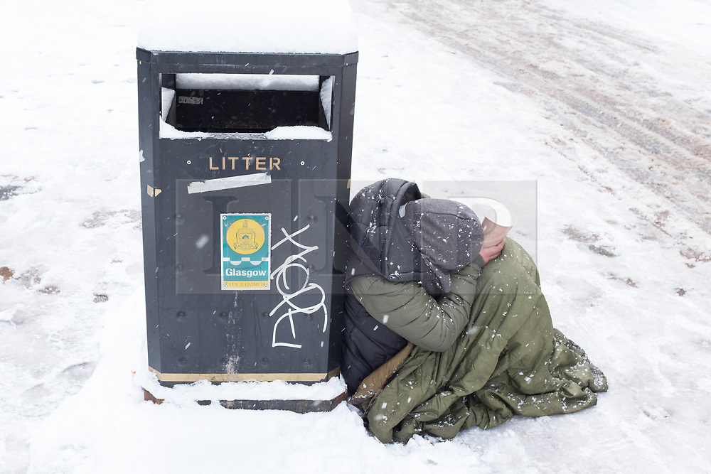 """© Licensed to London News Pictures. 28/02/2018. <br /> <br /> A homeless person shivers in the cold as Glasgow, Scotland is hit with snow storm """"Beast from the East"""" on 28th February 2018.<br /> <br /> Photo credit should read Max Bryan/LNP"""