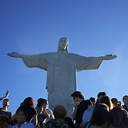 Visitors at the iconic Cristo Redentor, Christ the Redeemer statue sits atop the mountain Corcovado. The Christ statue was voted one of the seven wonders of the modern world in 2007. It was designed by Brazilian Heitor de Silva Costa and was inaugurated in 1931 having taken years to assemble. Rio de Janeiro, Brazil. 21st July 2010. Photo Tim Clayton..