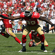 San Francisco 49ers linebacker Aldon Smith (99) blocks as San Francisco 49ers kicker David Akers (2) kicks during an NFL football game between the Dallas Cowboys and the San Francisco 49ers at Candlestick Park on Sunday, Sept. 18, 2011 in San Francisco, CA.  (Photo/Alex Menendez)