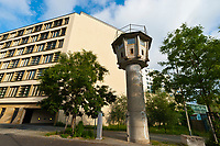 An East German guard tower along the Berlin Wall that still stands along a street, Mitte, Berlin, Germany