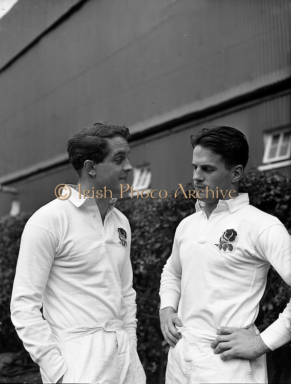 England players, J W Clements, left, and J G G Hetherington, right, discuss tactics before the start of the game against Ireland on Saturday 14th February 1959,..Irish Rugby Football Union, Ireland v England, Five Nations, Landsdowne Road, Dublin, Ireland, Saturday 14th February, 1959,.14.2.1959, 2.14.1959,..Referee- D Gwynne Walters, Welsh Rugby Union, ..Score- Ireland 0 - 3 England, ..Irish Team, ..N J Henderson, Wearing number 15 Irish jersey, Full back, N.I.F.C, Rugby Football Club, Belfast, Northern Ireland,..N H Brophy, Wearing number 14 Irish jersey, Right wing, University College Dublin Rugby Football Club, Dublin, Ireland, ..A J O'Reilly, Wearing number 13 Irish jersey, Right Centre, Old Belvedere Rugby Football Club, Dublin, Ireland, and, Leicester Rugby Football Club, Leicester, England, ..J F Dooley, Wearing  Number 12 Irish jersey, Left Centre, Galwegians Rugby Football Club, Galway, Ireland, ..A C Pedlow, Wearing number 11 Irish jersey, Left wing,  C I Y M S Rugby Football Club, Belfast, Northern Ireland, ..M A English, Wearing number 10 Irish jersey, Outside Half, Bohemians Rugby Football Club, Limerick, Ireland,..A A Mulligan, Wearing number 9 Irish jersey, Scrum Half, London Irish Rugby Football Club, Surrey, England, ..B G Wood, Wearing number 1 Irish jersey, Forward, Garryowen Rugby Football Club, Limerick, Ireland, ..A R Dawson, Wearing number 2 Irish jersey, Captain of the Irish team, Forward, Wanderers Rugby Football Club, Dublin, Ireland, ..S Millar, Wearing number 3 Irish jersey, Forward, Ballymena Rugby Football Club, Antrim, Northern Ireland,..W A Mulcahy, Wearing number 4 Irish jersey, Forward, University College Dublin Rugby Football Club, Dublin, Ireland, ..M G Culliton, Wearing number 5 Irish jersey, Forward, Wanderers Rugby Football Club, Dublin, Ireland, ..N A Murphy, Wearing number 6 Irish jersey, Forward, Cork Constitution Rugby Football Club, Cork, Ireland,..P J A O' Sullivan, Wearing  Number 7 Irish jersey, Forward, Galwegians Rug