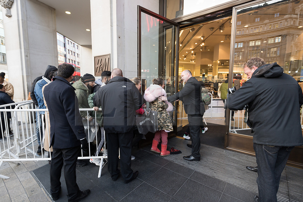 © Licensed to London News Pictures. 08/11/2018. London, UK. Customers queue outside the HM store in Oxford Circus to buy the Jeremy Scott H&M X Moschino collection.<br /> Photo credit: Ray Tang/LNP