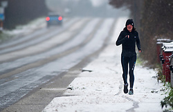 © Licensed to London News Pictures 16/01/2021.        Sevenoaks, UK. An early morning runner in the snow in Sevenoaks, Kent. Snow falls across some parts of Kent over night. A yellow weather warning is in place for snow and ice today. Photo credit:Grant Falvey/LNP