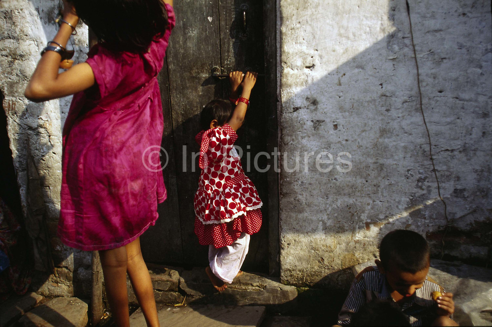 Children play in the alleyways of the Shadipur slum<br /> The Kathiputli Colony in the Shadipur Depot slum is home to hundreds of (originally Rajasthani) performers. The artistes who live here - from magicians, acrobats, musicians, dancers and puppeteers are often international renowed by always return to the Shadipur slum.