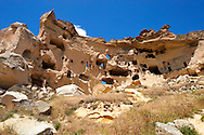 Troglodyte cave houses in tuff volcanic rock, Cappadocia, Anatolia, Turkey .<br /> <br /> If you prefer to buy from our ALAMY PHOTO LIBRARY  Collection visit : https://www.alamy.com/portfolio/paul-williams-funkystock/cappadociaturkey.html (TIP refine search - type which part of Cappadocia into the LOWER search box)<br /> <br /> Visit our TURKEY PHOTO COLLECTIONS for more photos to download or buy as wall art prints https://funkystock.photoshelter.com/gallery-collection/3f-Pictures-of-Turkey-Turkey-Photos-Images-Fotos/C0000U.hJWkZxAbg