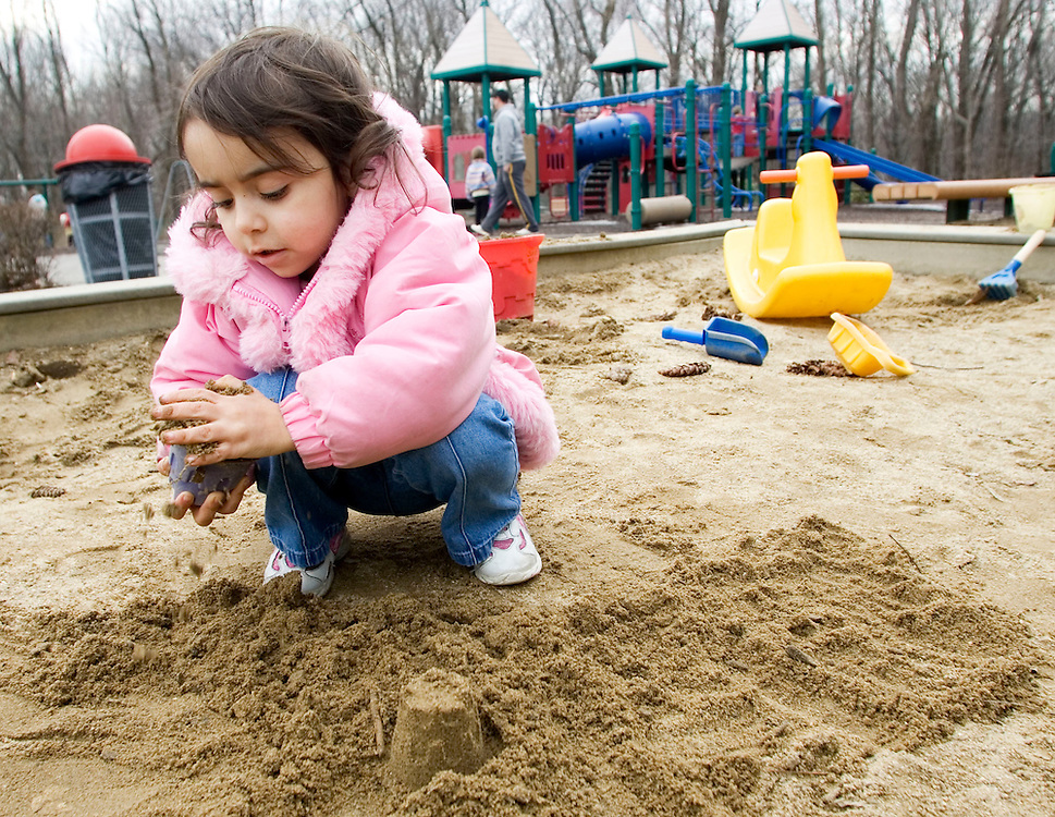 PROSPECT, CT- 13 MARCH 07- 031307JT03- .Alana Torres, 3, of Prospect, builds sand castles at the playground at Hotchkiss Park in Prospect on Tuesday..Josalee Thrift Republican-American
