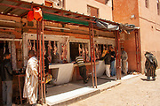 Open Air butcher shop with sheep carcasses on display. Photographed in a remote, rural village in Morocco