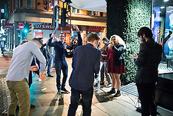© Licensed to London News Pictures . 01/01/2015 . Manchester , UK . People dance to buskers on Deansgate .  Revellers usher in the New Year on a night out in Manchester City Centre .  Photo credit : Joel Goodman/LNP