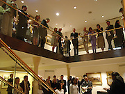 Partygoers listening to A and O who got together at the Hackney Empire. Fundraising evening in aid of Education at the Hackney Empire. Hosted by Fleming Family and partners at The Fleming collection. Berkeley St.  24 June 2004. SUPPLIED FOR ONE-TIME USE ONLY-DO NOT ARCHIVE. © Copyright Photograph by Dafydd Jones 66 Stockwell Park Rd. London SW9 0DA Tel 020 7733 0108 www.dafjones.com