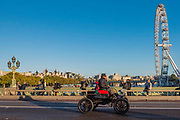 Passing over  over Westminster bridge as the sun rises - The London to Brighton Veteran Car Run, which dates back to 1927, was founded to commemorate the Emancipation Run of 1896, which celebrated the new-found freedom of motorists granted by the 'repeal of the Red Flag Act.' The Act raised the speed limit to 14mph and abolished the need for a man carrying a red flag to walk ahead of the cars whenever they were being driven. It is the longest running motoring event in the world, this year has a French theme in honour of the country's contribution to motoring's early days. It is is organised by the Royal Automobile Club.