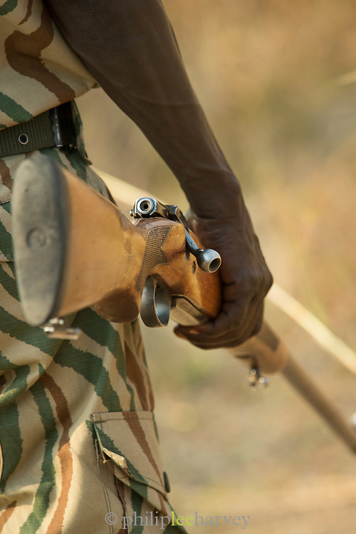 Gun detail with park ranger, South Luangwa National Park. Zambia, Africa