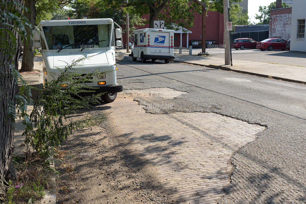 Olive Street in the City of New Haven is paved first with Bricks as seen here when Milling has been done to repave the roadway.