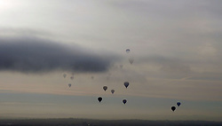 Balloons ascend in to the sky on the press launch for the 2016 Bristol Balloon Fiesta at Ashton Court Estate, Bristol.