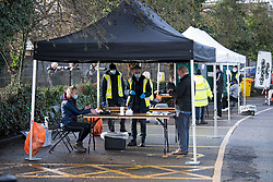 © Licensed to London News Pictures. 02/02/2021. London, UK. Members of the public take part in testing at a new Variant Testing Centre in Ealing, West London, set up after the discovery of a new South African variant of coronavirus. Door-to-door delivery of free home test kits is to start in the area in an attempt to slow the spread of the more aggressive strain of the virus. Photo credit: Ben Cawthra/LNP