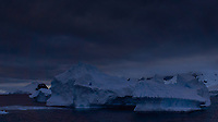Iceberg at Night off the North-West Antarctica Peninsula. From the deck of the Hurtigruten MS Fram on New Year's Eve. You want to stay clear of the icebergs at night. Image taken with a Leica T camera and 18-56 mm lens (ISO 100, 23 mm, f/8, 1/500 sec). Raw image processed with Capture One Pro 8, and Photoshop CC.