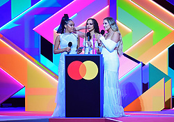 Little Mix accepts the award for Best British Group during the Brit Awards 2021 at the O2 Arena, London. Picture date: Tuesday May 11, 2021.