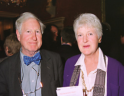 SIR STEPHEN & LADY TUMIN at a reception in London on 20th April 1999.MRF 40