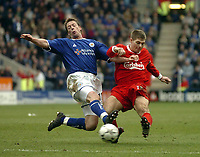 Photo. Glyn Thomas.<br /> Leicester City v Liverpool. FA Barclaycard Premiership.<br /> Walkers Stadium, Leicester. 28/03/2004.<br /> Leicester City's Steffen Freund (L) is unable to prevent Liverpool's Steven Gerrard from getting a shot in on goal.