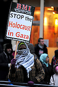 London 04/01/09: Protests outside the Israeli Embassy in London UK: A woman makes a silent protest