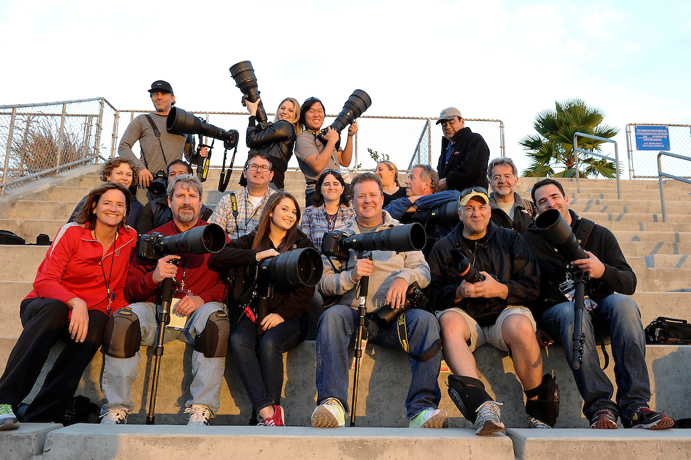 11/16/13 --- SPORTS SHOOTER ACADEMY-MINI --- YORBA LINDA, CA: Sports Shooter Academy participants pose for a group photo after the Santa Ana College - Fullerton College football game during the SSA-Mini. Photo by Deanna Hanashiro, Sports Shooter Academy Behind the Scenes