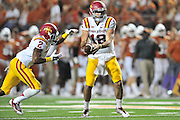 AUSTIN, TX - OCTOBER 18:  Sam B. Richardson #12 of the Iowa State Cyclones hands the ball off to Aaron Wimberly #2 against the Texas Longhorns on October 18, 2014 at Darrell K Royal-Texas Memorial Stadium in Austin, Texas.  (Photo by Cooper Neill/Getty Images) *** Local Caption *** Sam B. Richardson; Aaron Wimberly