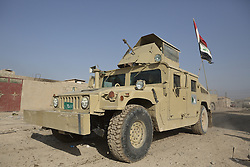 November 11, 2016 - Mosul, Nineveh, Iraq - 11/11/2016. Mosul, Iraq. An armoured Humvee, belonging to the Iraqi Army's 9th Armoured Division, drives through Mosul's Hay Intisar district on the south east of the city. The district was taken by Iraqi Security Forces (ISF) around a week ago and, despite its proximity to ongoing fighting between ISF and ISIS militants, many residents still live in the settlement...The battle to retake Mosul, which fell June 2014, started on the 16th of October 2016 with Iraqi Security Forces eventually reaching the city on the 1st of November. Since then elements of the Iraq Army and Police have succeeded in pushing into the city and retaking several neighbourhoods allowing civilians living there to be evacuated - though many more remain trapped within Mosul. (Credit Image: © Matt Cetti-Roberts via ZUMA Wire)
