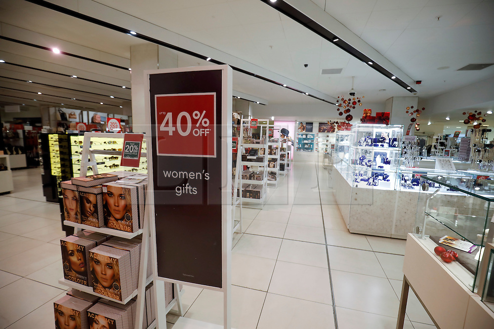 """© Licensed to London News Pictures. 25/11/2016. London, UK. Empty shopping aisles in Debenhams on Oxford Street, London, in the early hours on """"Black Friday"""". Sales from this years Black Friday event are expected to top £2 billion. Photo credit: Tolga Akmen/LNP"""