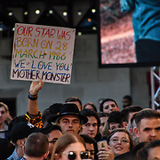 A man holding a banner written A Star is Born attend A Star Is Born UK Premiere at Vue Cinemas, Leicester Square, London, UK 27 September 2018.