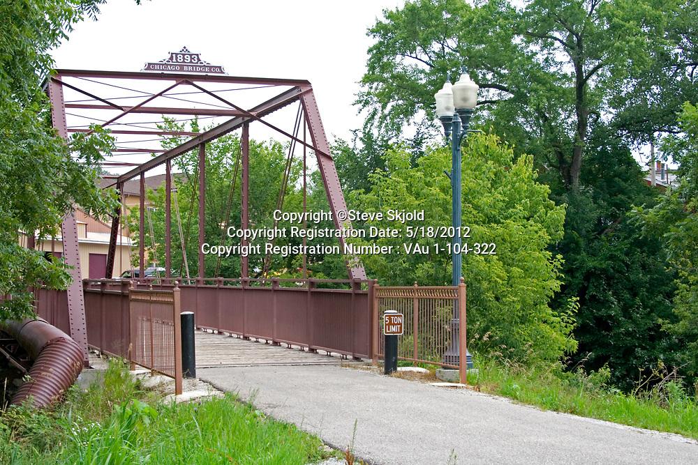 Historic Root River State Trail railroad bridge crossing the Root River leading to downtown area. Lanesboro Minnesota MN USA