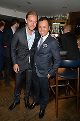 Left to right, ANDREAS HOLTZ and SENG KHOU at the launch of Geisha at Ramusake hosted by Piers Adam and Marc Burton at Ramusake, 92B Old Brompton Road, London on 11th June 2015.