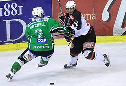 Kevin Mitchell and Marjan Manfreda at 39th Round of EBEL League ice hockey match between HDD Tilia Olimpija and HK Acroni Jesenice, on December 30, 2008, in Arena Tivoli, Ljubljana, Slovenia. Tilia Olimpija won 4:3. (Photo by Vid Ponikvar / SportIda).