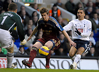 Photo: Ed Godden/Sportsbeat Images.<br /> Tottenham Hotspur v Newcastle United. The Barclays Premiership. 14/01/2007. Newcastle's Paul Huntington (centre), holds off Aaron Lennon (R).