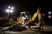 A road crew works at night under spotlights in Phoenix, Arizona.