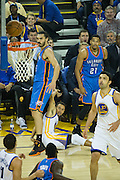Golden State Warriors guard Stephen Curry (30) watches a missed three point attempt as Oklahoma City Thunder center Steven Adams (12) walks over him at Oracle Arena in Oakland, Calif., on November 3, 2016. (Stan Olszewski/Special to S.F. Examiner)