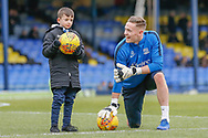Southend United goalkeeper Nathan Bishop (13) with a young mascot before the EFL Sky Bet League 1 match between Southend United and Luton Town at Roots Hall, Southend, England on 26 January 2019.