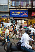 Traffic outside Ghantewala Confectioners on Chadni Chowk, Old Delhi, India<br /> The Ghantewala Halwai in Chandni Chowk in Delhi, was established in 1790 and is one of the oldest halwais (traditional sweet shop) in India