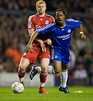 LIVERPOOL, ENGLAND - Tuesday, April 22, 2008: Chelsea's Didier Drogba runs into Liverpool's John Arne Riise during the UEFA Champions League Semi-Final 1st Leg match at Anfield. (Photo by David Rawcliffe/Propaganda)