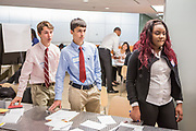 Purchase, NY – 31 October 2014. White Plains High School team members Robert Lovitch, Matthew Garrison, and Samarsha Drysdale listening to a colleague's practice presentation. White Plains High School went on to take first place in the 2014 competition. The Business Skills Olympics was founded by the African American Men of Westchester, is sponsored and facilitated by Morgan Stanley, and is open to high school teams in Westchester County.