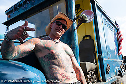 Ryan Markowsky of Las Vegas, NV showed off his tattoos at the Rats Hole annual custom bike show in the Crossroads area of the Buffalo Chip during the Sturgis Black Hills Motorcycle Rally. SD, USA. Thursday, August 8, 2019. Photography ©2019 Michael Lichter.