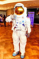 Garden City, New York, U.S. July 20, 2019. Volunteer TOM RUHLE wears NASA space suit of astronaut C. Duke at the Moon Fest Apollo at 50 Countdown Celebration at Cradle of Aviation Museum in Long Island during the same time Apollo 11 Lunar Module, landed on the Moon 50 years ago.