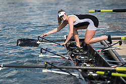 © London News Pictures. 05/07/2012.  Henley-on-Thames, UK. A female rower from Molesey Boat Club adjusting her boat in the sunshine on Day three of Henley Royal Regatta on the River Thames at Henley-on-Thames, Oxfordshire on July 03, 2013. The 5 day regatta over the first weekend in July, races head-to-head knock out competitions over a course of 1 mile between rowing teams from throughout the world. Photo credit: Ben Cawthra/LNP