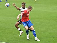Football - 2020 / 2021 Sly Bet Championship - Swansea City vs Queens Park Rangers - Liberty Stadium<br /> <br /> Jamal Lowe of Swansea City on the attack Robert Dickie of QPR defends <br /> <br /> COLORSPORT/WINSTON BYNORTH