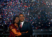 U.S. Democratic presidential nominee Senator Barack Obama (D-IL) embraces his wife Michelle following his address at the 2008 Democratic National Convention in Denver, Colorado August 28, 2008.   REUTERS/Jim Young