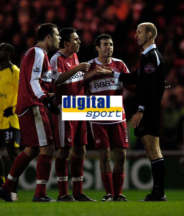 Photo: Jed Wee.<br /> Middlesborough v Arsenal. The Barclays Premiership. 03/02/2007.<br /> <br /> Middlesbrough players protest as referee Mike Riley (R) prepares to show Mark Viduka (L) the yellow card.