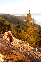 Doug Nurock mountain biking along the Flume Trail. Lake Tahoe, CA<br />