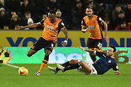 Bolton Wanderers midfielder Mark Davies does nasty sliding tackle on Hull City midfielder Moses Odubajo during the Sky Bet Championship match between Hull City and Bolton Wanderers at the KC Stadium, Kingston upon Hull, England on 12 December 2015. Photo by Ian Lyall.