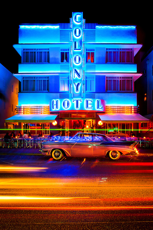 The Colony Hotel, designed by architect Henry Hohauser in 1935, is a landmark on neon-drenched Ocean Drive, an icon in the Tropical Deco style for which this Miami Beach neighborhood is famous. A 1957 Packard car is parked in front. This photo was made in the early 1990s.