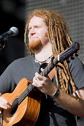 Newton Faulkner on the main stage at T in the Park Friday 11 July 2008..T in the Park 2008 festival took place on the Friday 10th July, Saturday 11th July and Sunday 12th July, at Balado, near Kinross in Perth and Kinross, Scotland..Pic ©Michael Schofield. All Rights Reserved..